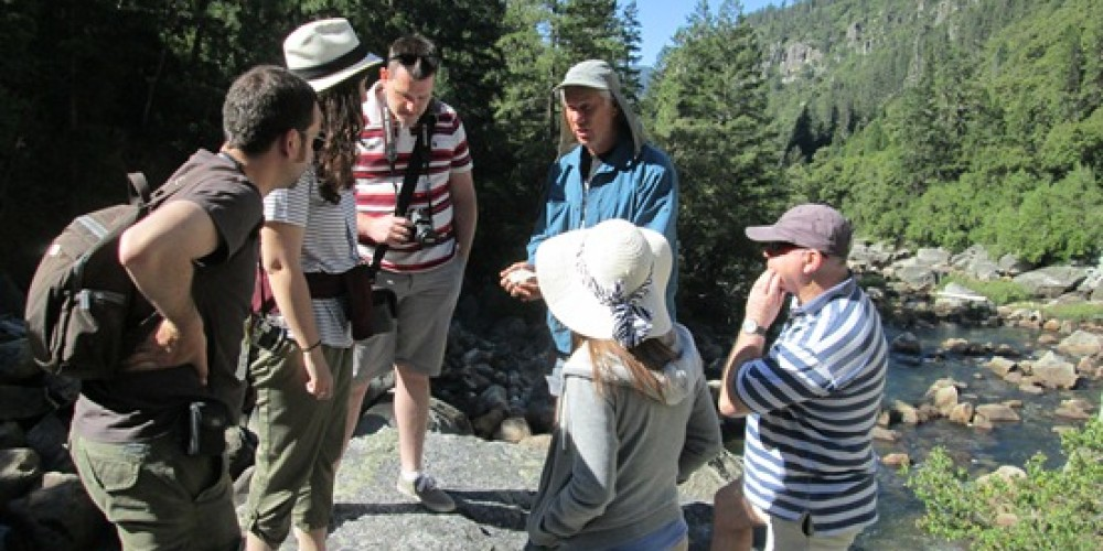 Guide explains formation of Yosemite's rocks in Merced River Canyon.
