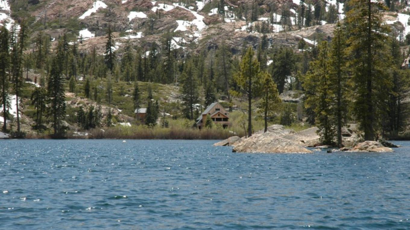 Salmon Lake in the spring time, with Salmon Lake Lodge across the water. – Mary Davey