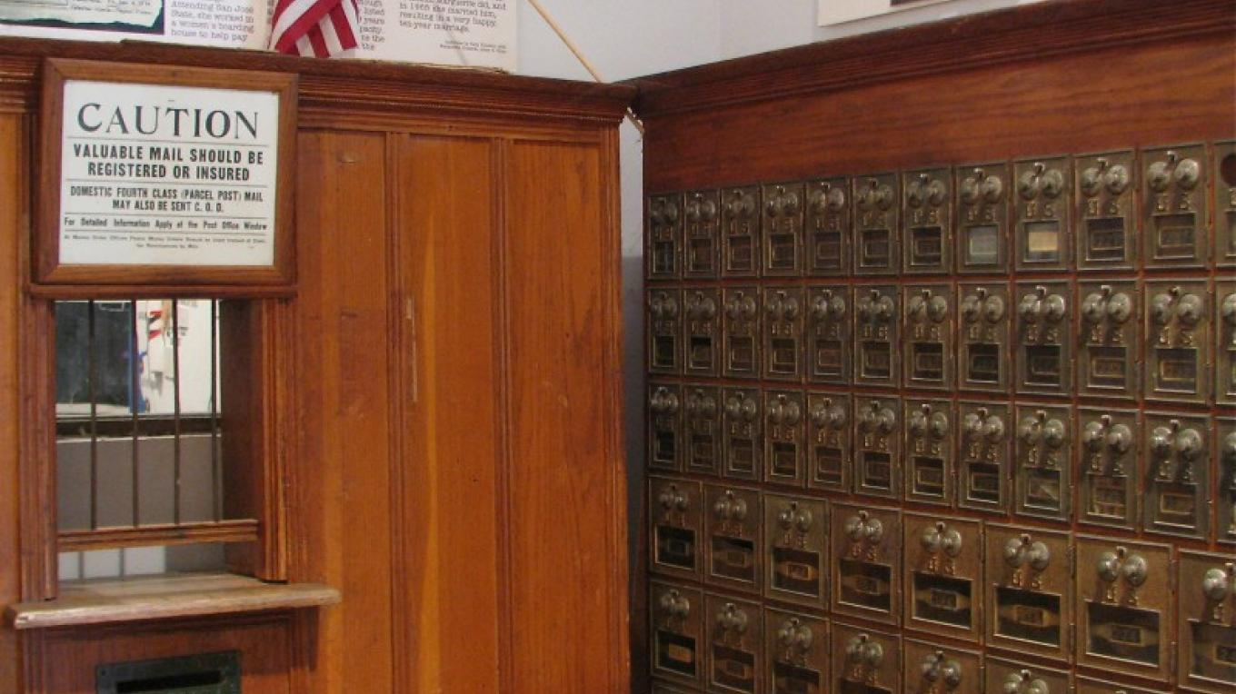 These are genuine post boxes. They were originally in the building across the street, now occupied by The Kitchen Store.  Similar ones are still in use in the Amador City Post Office, where all residents get their mail. – Karrie Lindsay