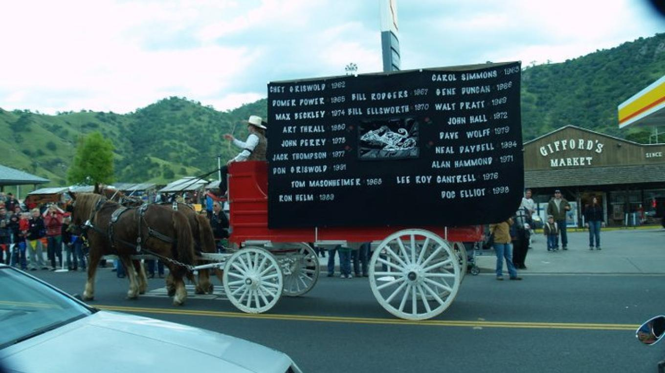 The horse-drawn hearse memorializes deceased wagon masters who led the Jackass Mail Run in earlier years. – Joyce Eisenberry