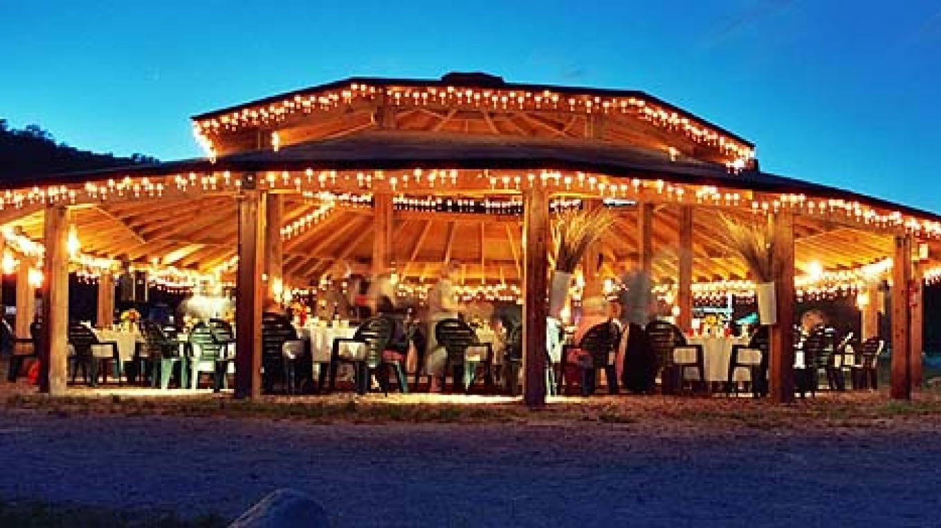2,000 sq. ft. round Pavilion for Weddings: dance floor, seating, music system, lighting.