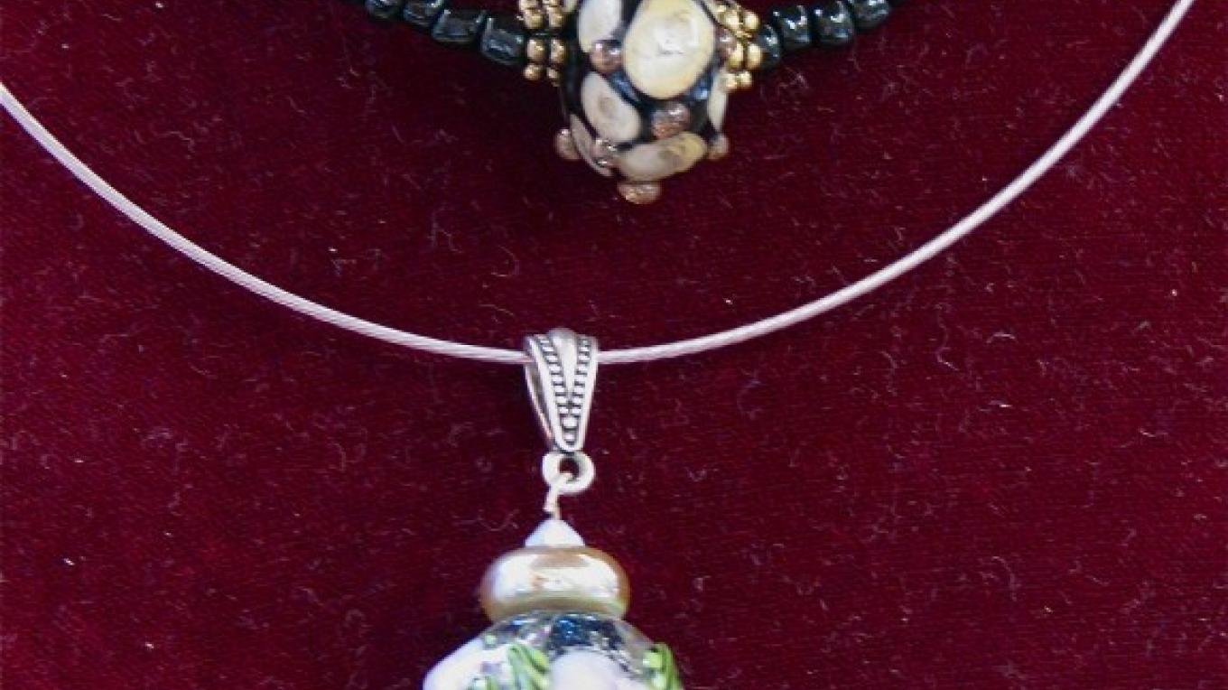 There is an extensive collection of Vickie Lee's exquisite handmade glass bead creations. – Karrie Lindsay