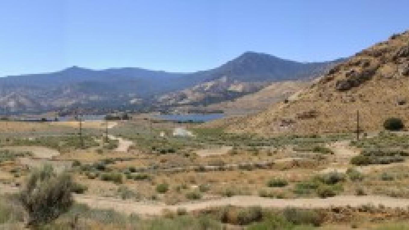 Cyrus Canyon OHV Area looking south toward Lake Isabella from center of track.  Parking area seen at far left with drop ins to track slightly to the right. (image created through Canon Photostitch) – Cody Norris
