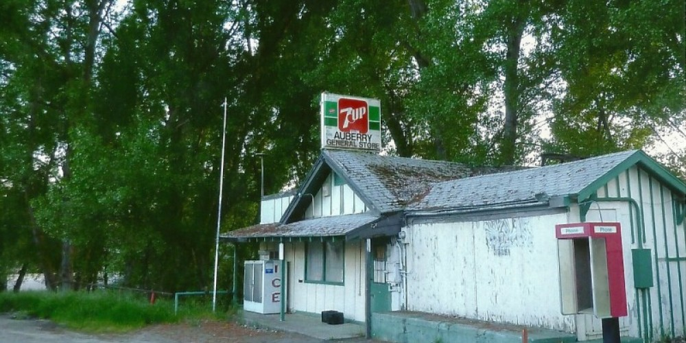 Witham's store, Auberry's oldest, became the post office and library, Dwayne's Barber shop and after Roots store burned down in 1970, Auberry General Store.  Currently vacant – Susan Leeper