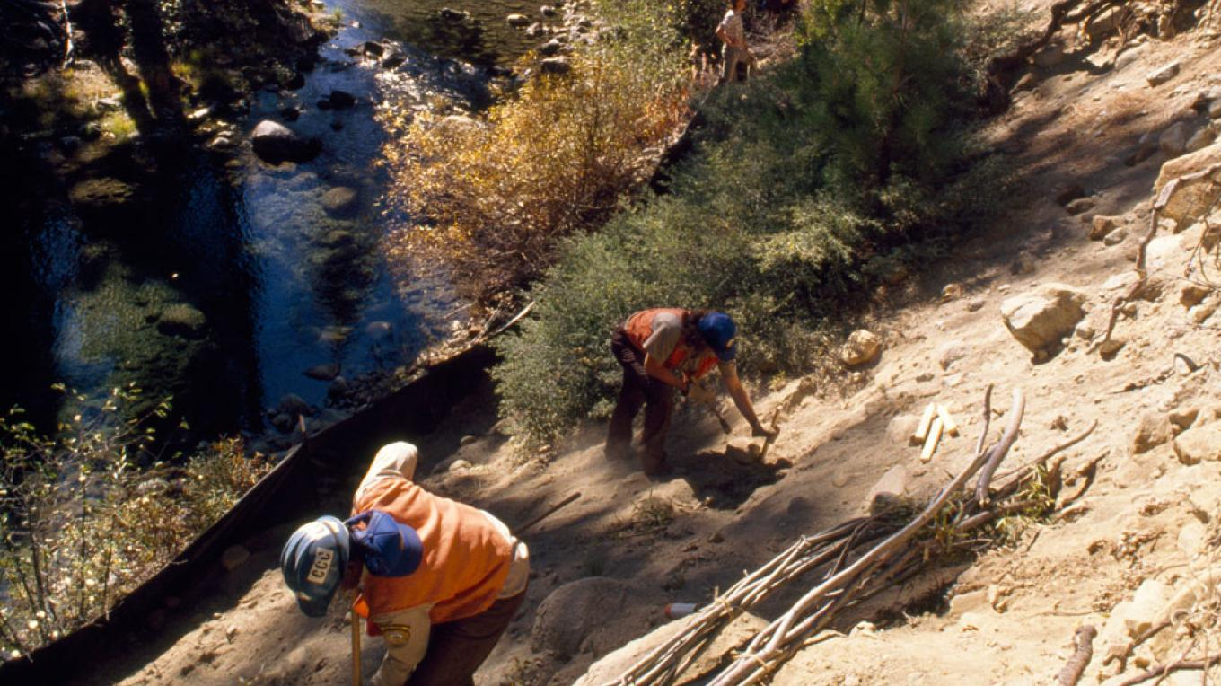 Volunteers from California Conservation Corps planting trees at Taylor Creek near Lake Tahoe. – Photo by George Mobley / National Geographic Creative