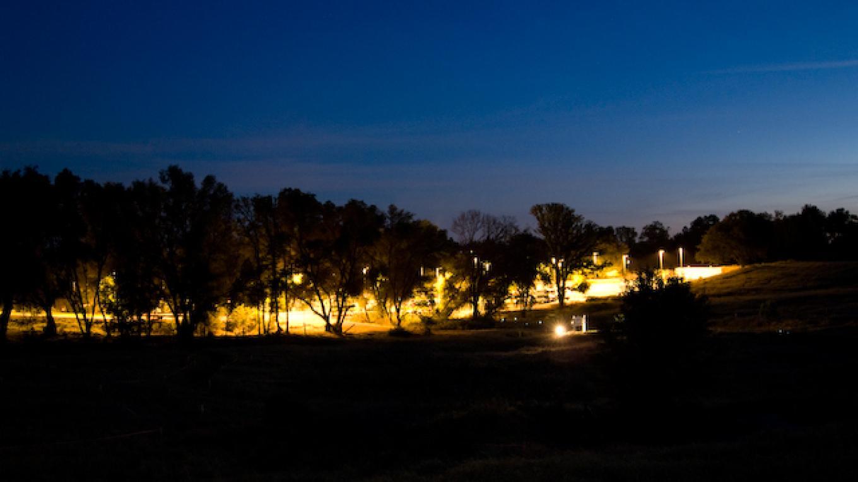 View of the El Dorado Center campus, at night,  facing South. – Adale van Dam
