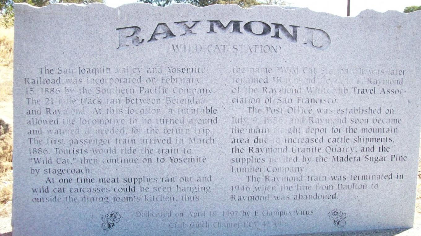 Historic marker explaining Raymond\'s beginning as a tourist route for rail and stagecoach to Yosemite. – Lynn Northrop