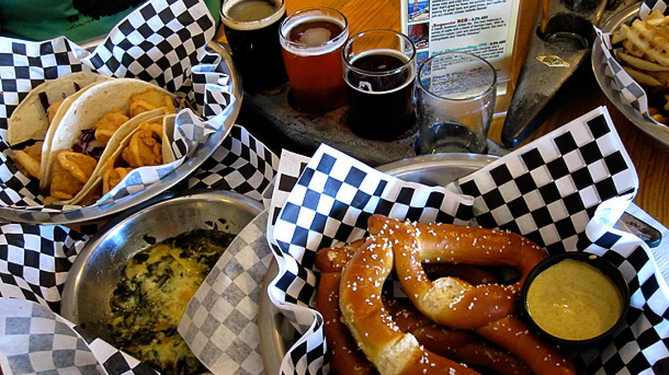 KRBC fish tacos, Sampler of 5oz glasses of KRBC beer, waffle fries & pretzels. – DrinkEatTravel.com