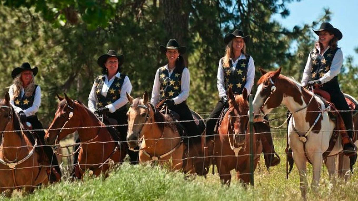 Cowgirls looking on from horseback at the events taking place on June 5th, 2010 – Al Golub