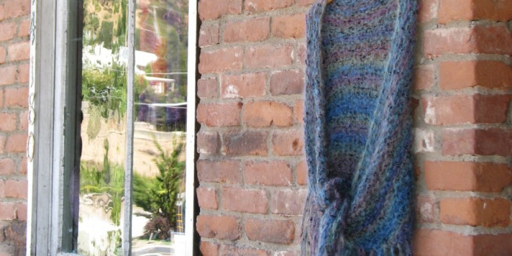 This tantalizing hand made shawl gestures to what you will experience inside. – Karrie Lindsay