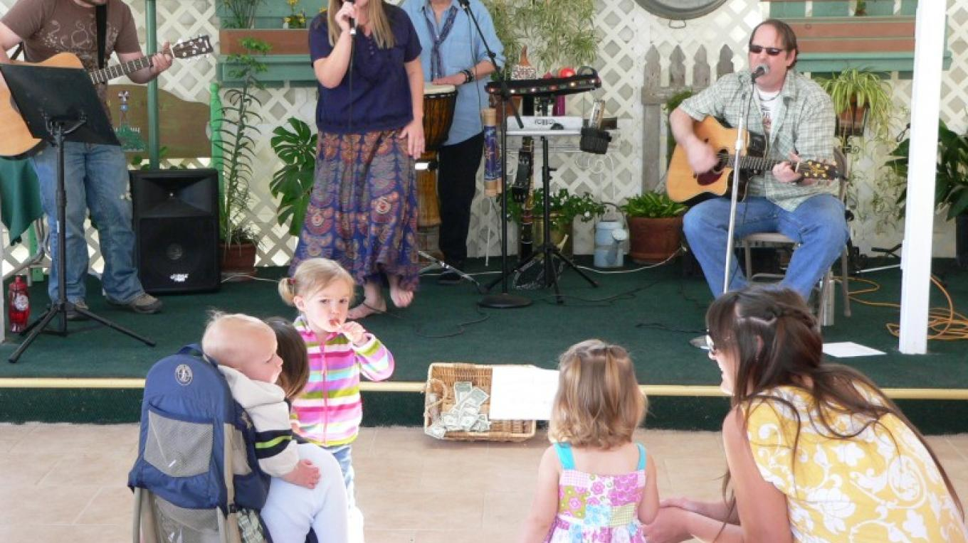 Families enjoy the music of popular local band Acoustic River. – David Dills