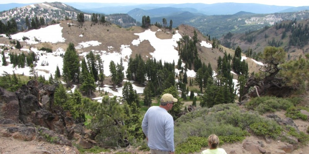 Hikers enjoy the views from the high country of the area around Bumpass Hell. – Ben Miles
