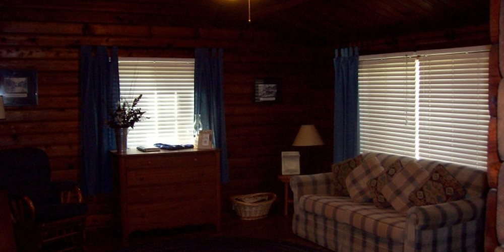 Photo of living room at Camp 4 1/2 cabin. – USDA-Forest Service