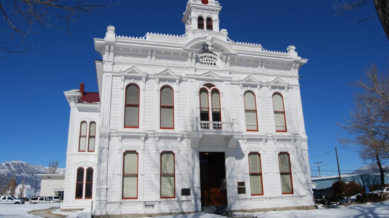 Snow on the courthouse lawn – Sarah McCahill