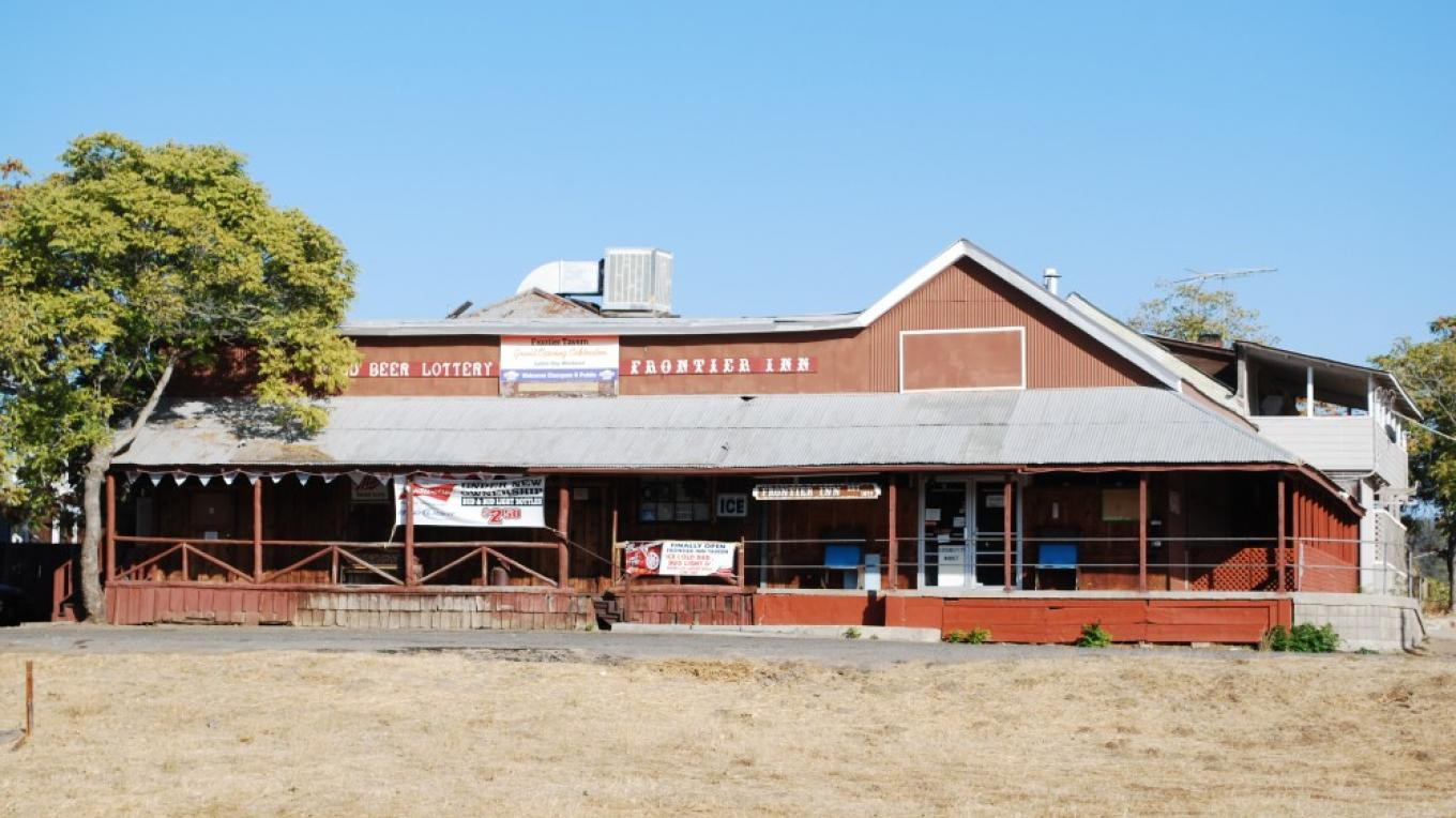 Formerly Shaw Brother\'s General Merchandise, est. 1890, now Frontier Bar. Building behind Shaw\'s was the home of the original phone company. Raymond Post Office has also been housed in this building. – Lynn Northrop