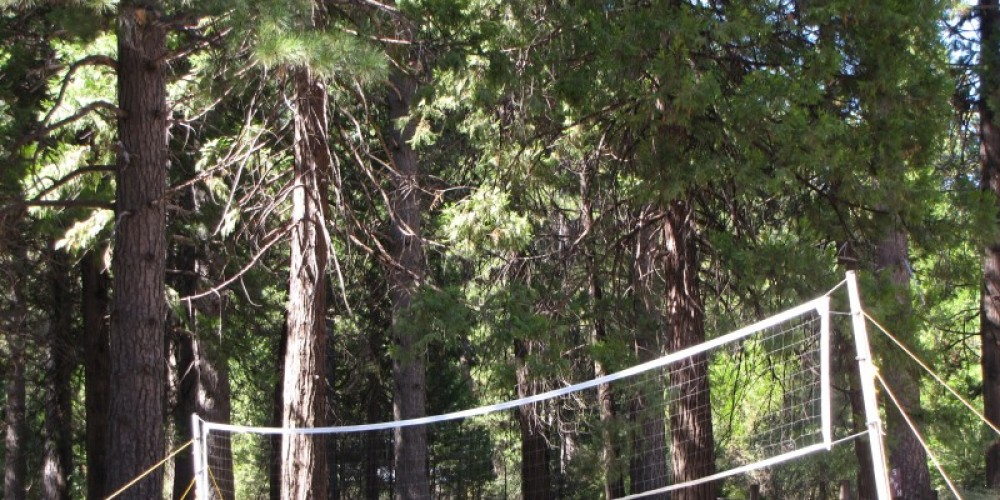 Volleyball in the pines at Mill Creek Eco Resort. – Ben Miles