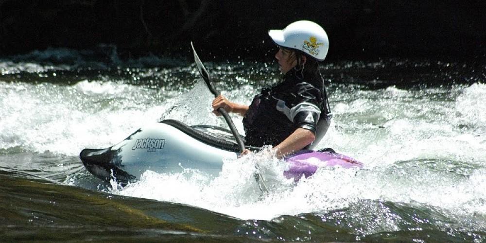 Evan Moore playboating on the Upper – Sierra South