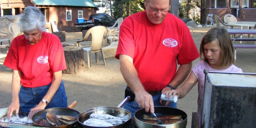 A community fish fry in progress at the central fire ring. – Duane Ruth-Heffelbower