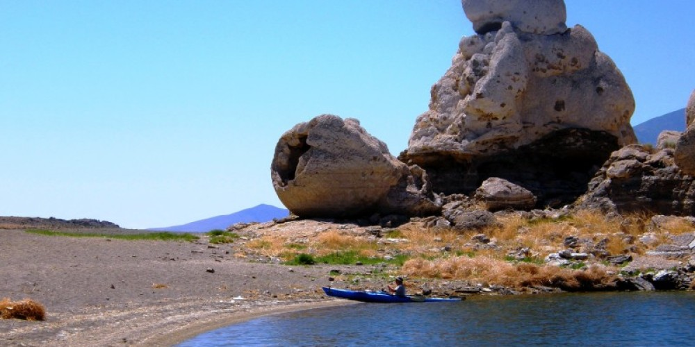 A Kayack pulls up next to the Stone Mother at Pyramid Lake. – Scott H. Carey