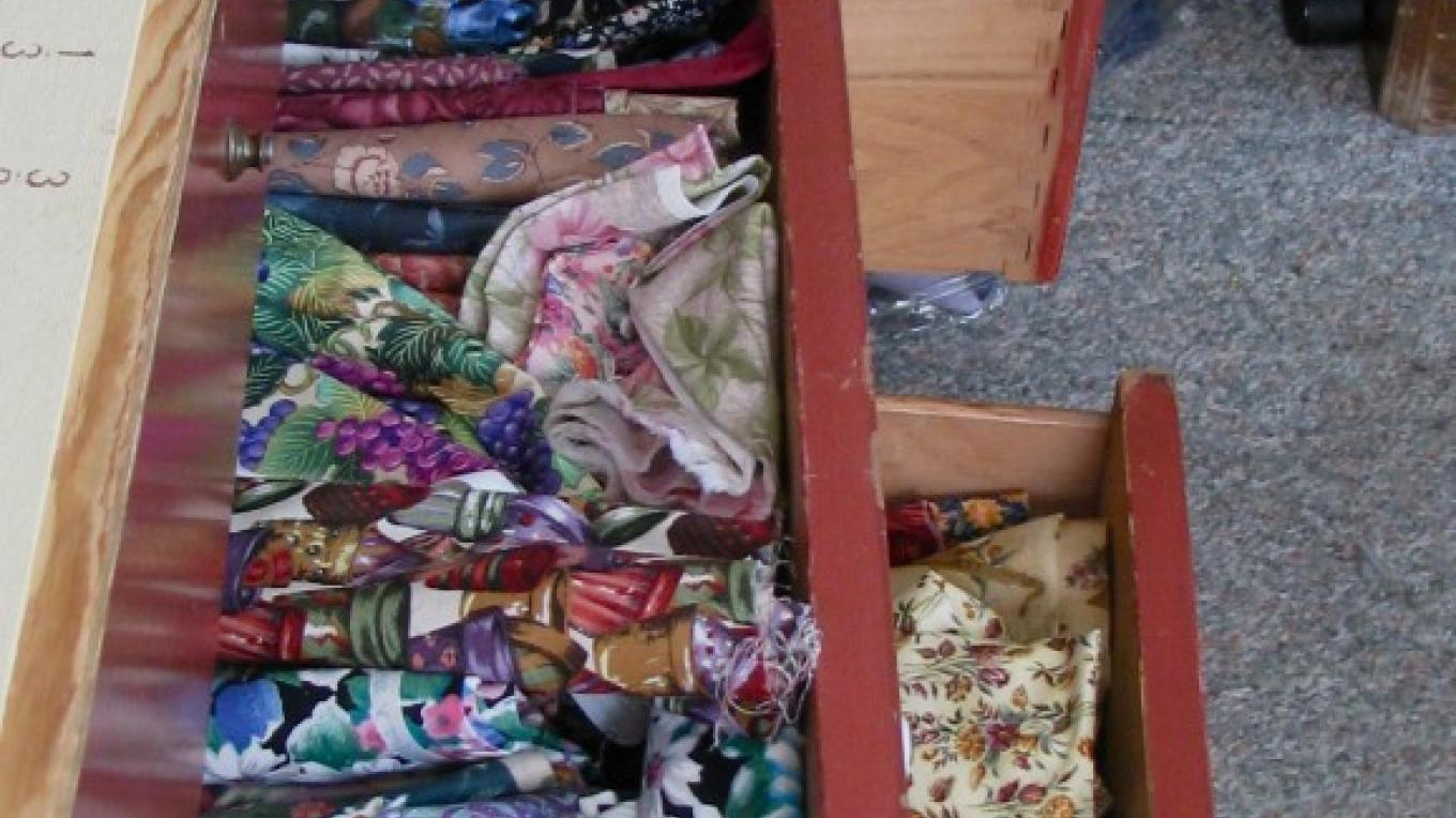 This is only a hint of Janet's stash of fabric. – Karrie Lindsay