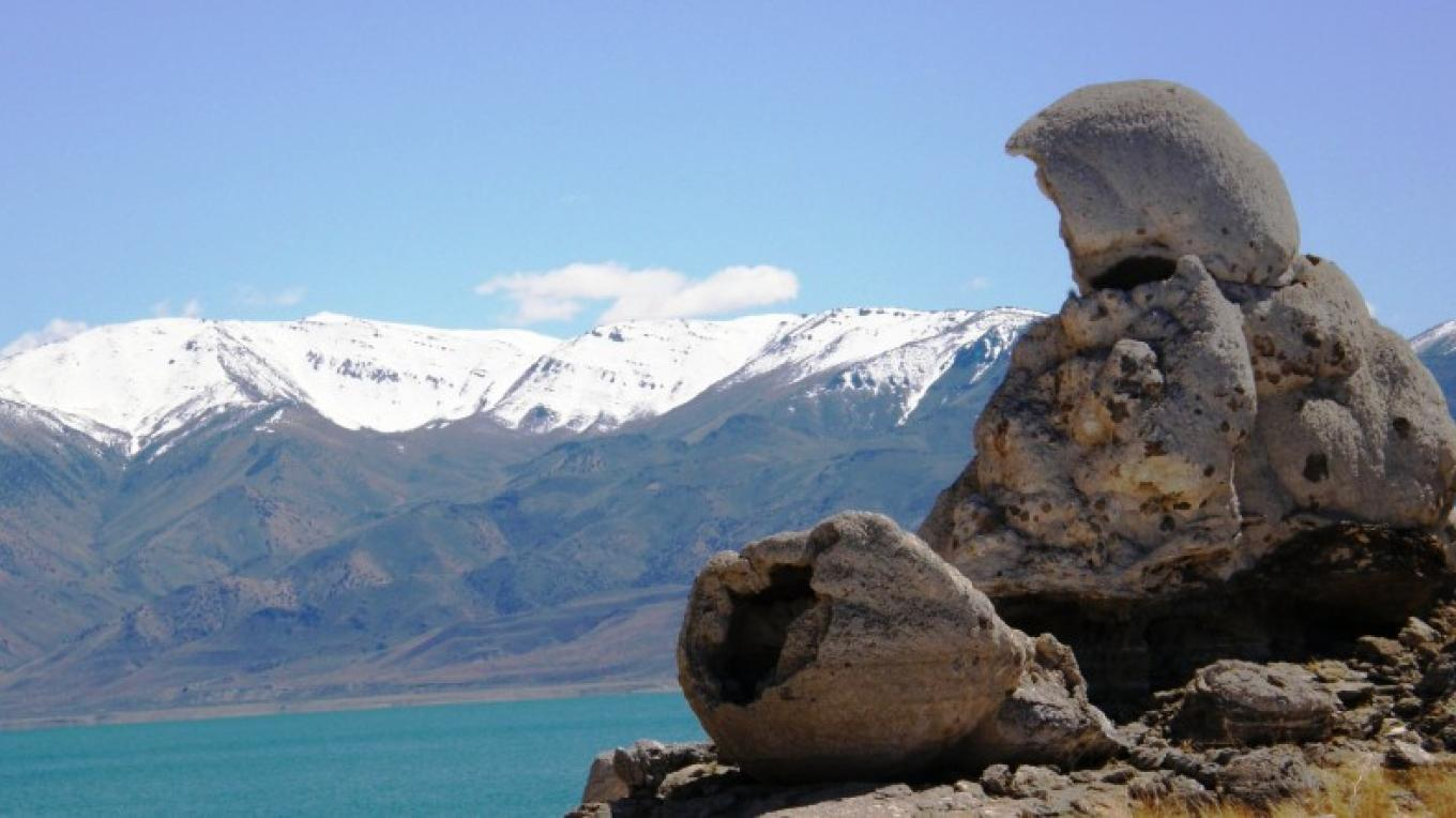 The Stone Mother with snow on the Pah Rah Mountains in the distance. – Scott H. Carey
