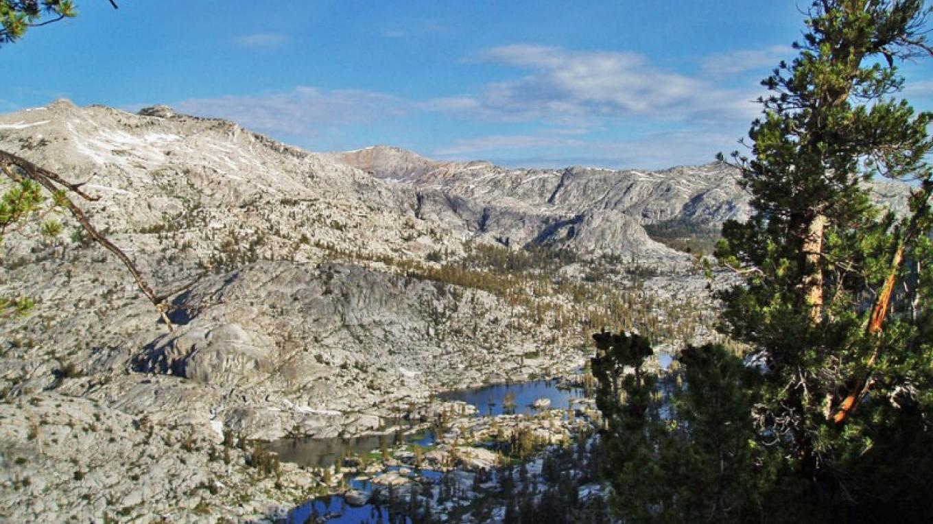 View of Granite Basin from where the trail tops the lateral moraine. – NPS