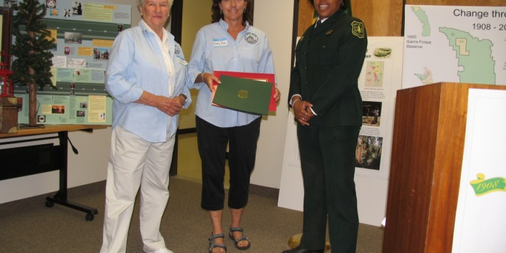 Foundation Directors Lea Dotters and Kathy Allison receiving Centennial Partnership Award from Forest Supervisor Tina Terrell. – Wendy Garton