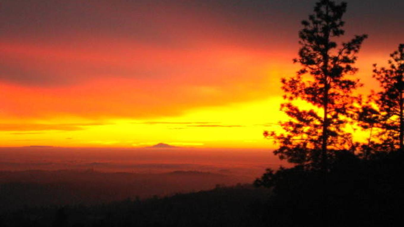 sunset from deck with fog in the central valley and Mt Diablo in the distance – CK Martin