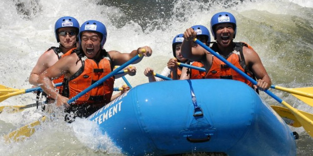 An excited group crashing through the waves at Satan's Cesspool on the South Fork! – Hotshot Imaging