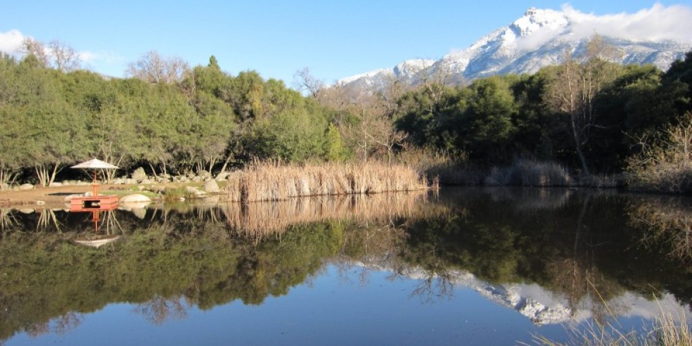 Swimming pond at Three Springs Ranch with Mt Dennison in the distance – Shelly McKnight