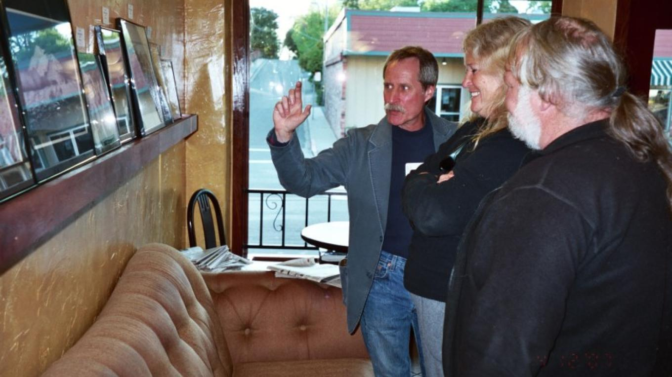 David Crosby shares information about his protographs at Depoe Bay Coffee Company during the Auburn Art Walk. – Ken Underwood