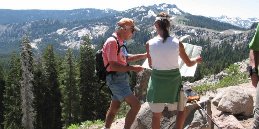 Hikers on Roller Pass check maps – Truckee Donner Chamber of Commerce