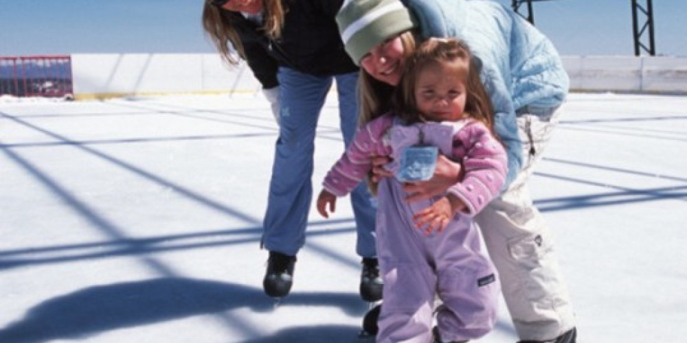 A family of ice skaters enjoys the Olympic Ice Pavilion located at High Camp, el. 8200' – Nathan Kendall