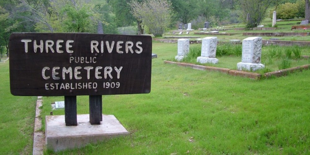 The Three Rivers Cemetery sign was hand-carved and donated by former Three Rivers resident Bill Stroh (1925-2009). At the top of the hill above the sign is where the quartz was mined for some of the earliest gravestones. – John Elliott