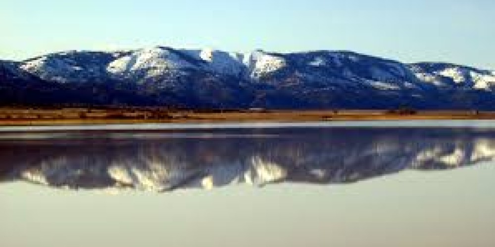 Warner Mts Reflected in Middle Alkili Lake, Surprise Valley, Cedarville, CA – Surprise Valley Chamber of Commerce
