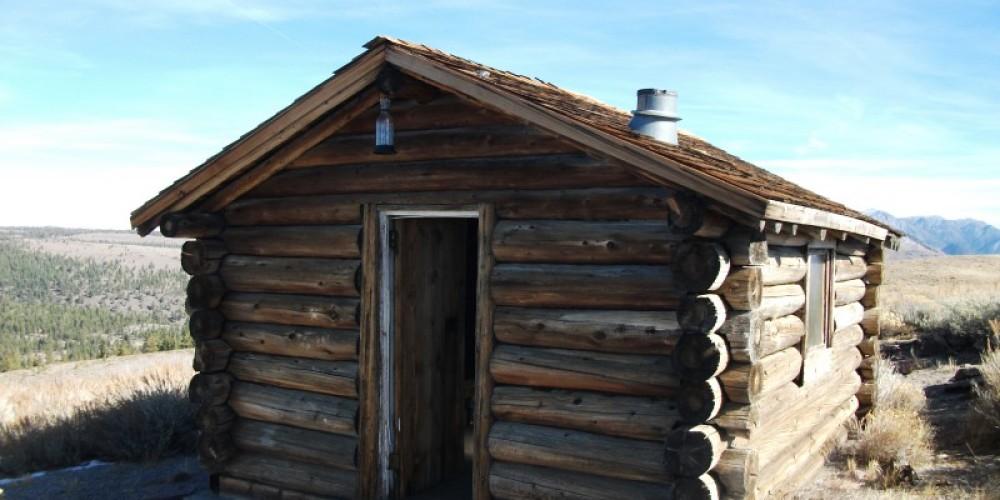 Bald Mtn. Log Cabin Warming Hut - Summer – DJ's Snowmobile Adventures, Inc.