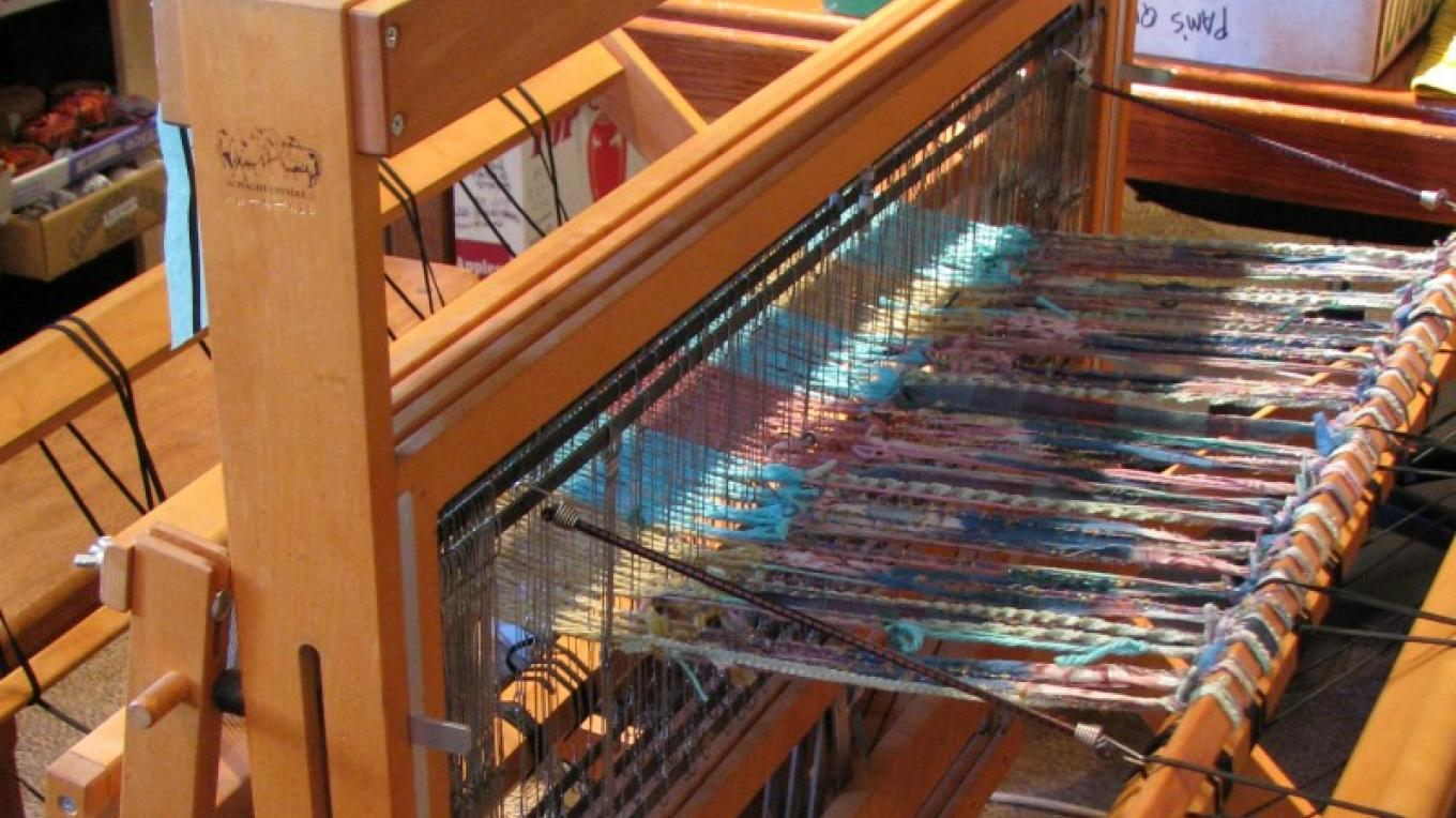 Shop owner, Carol Sethre, is often found weaving at her loom.  The store is her studio. – Karrie Lindsay