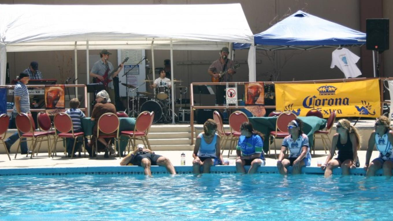 Bicyclists enjoying the pool listening to some great live music after the ride – Bonnie L. MacRae