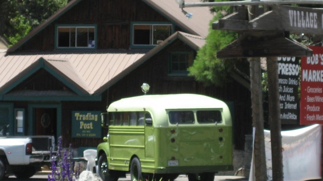 The Trading Post with the owners 1953 Ford school bus out front.  First school bus at the local Big Creek School – R. Sargentini