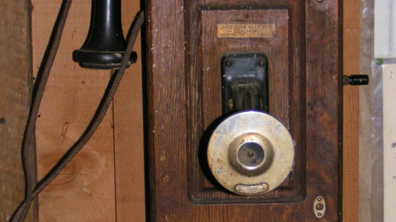 An old crank telephone used by the local phone company that started about 1895. – Jack Good