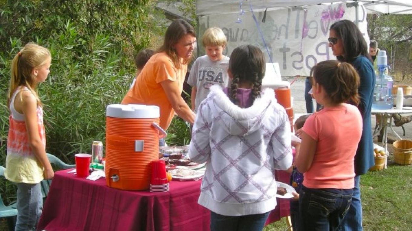 7th grade class fundraiser selling goodies to the party goers – CJS