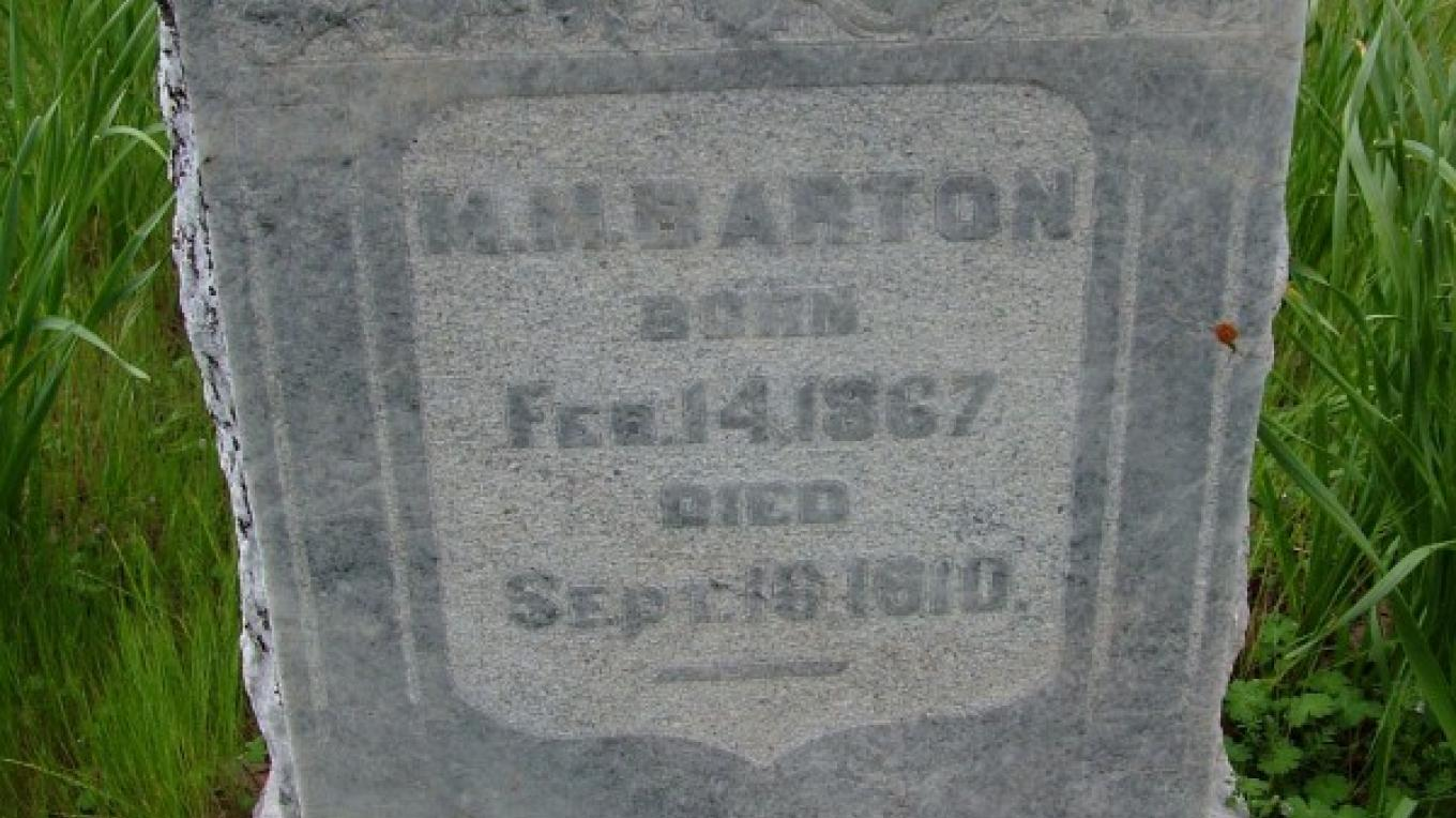The headstone of Mont Barton, who was accidentally electrocuted at the age of 43 and the first burial in the newly created cemetery. – John Elliott