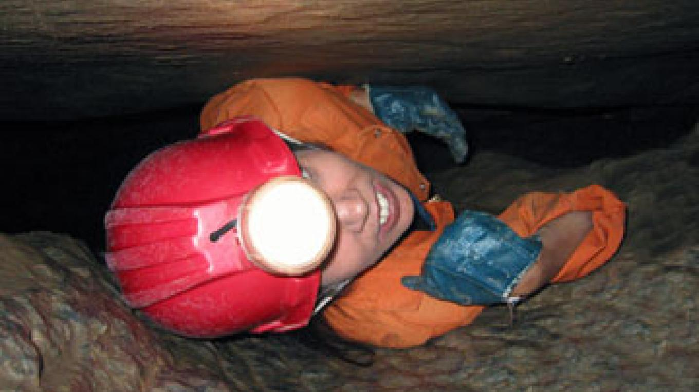 One of the tight squeezes on the 3-hour wild caving Adventure Trip at Moaning Cavern. – Bill Becher