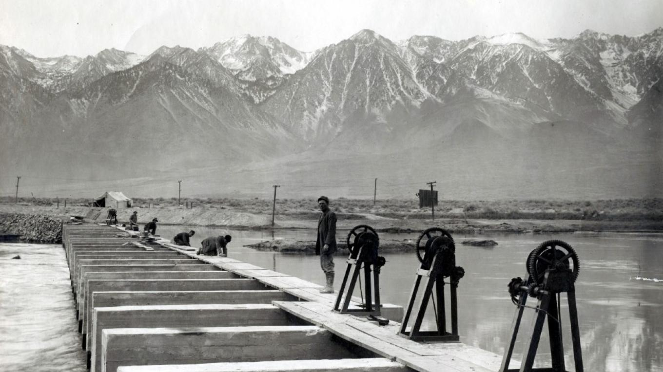The Sierra, whose snow pack feeds the Owens River and Los Angeles, tower above the LA Aqueduct Intake during construction in 1913. – Courtesy Eastern California Museum