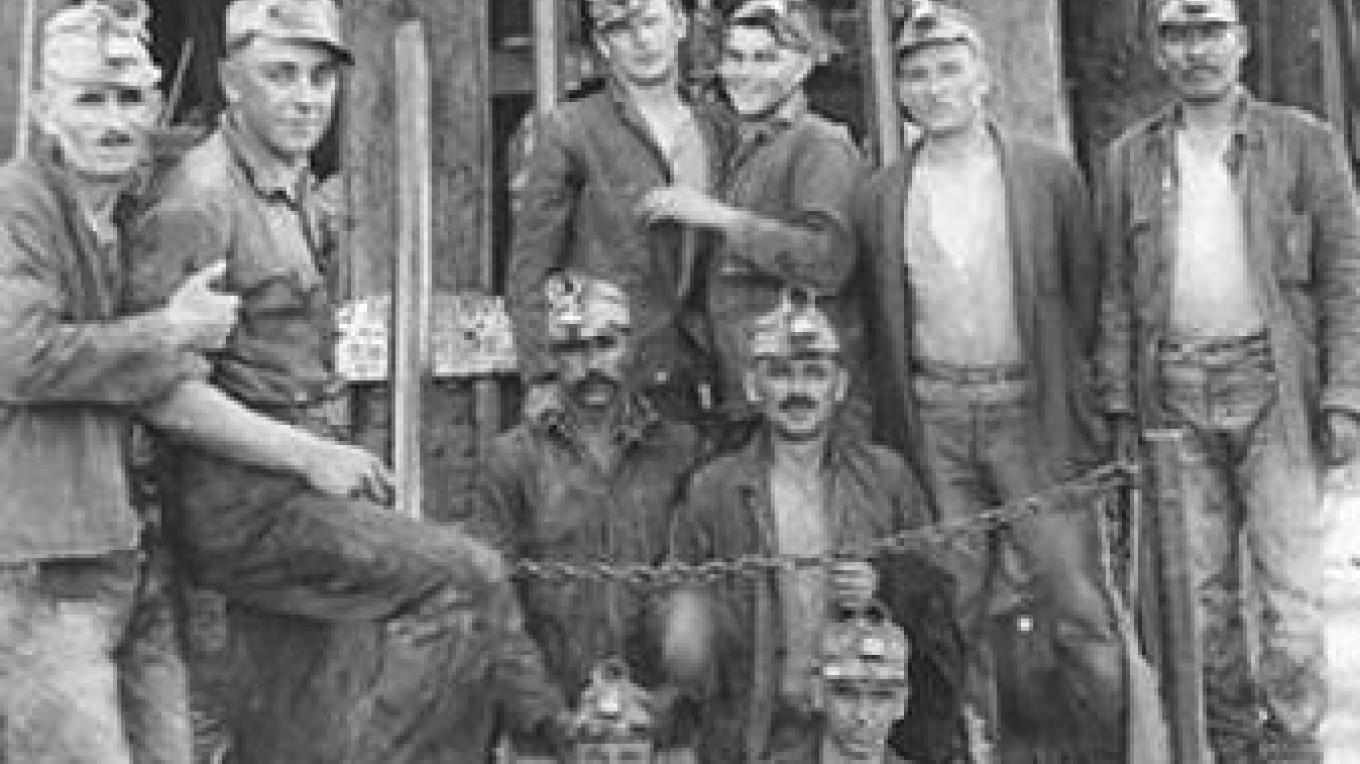 Miners pose during a break – miningartifacts.org