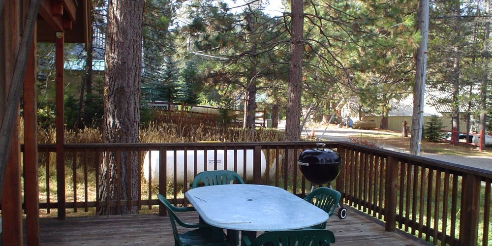 Sugar Pine Cabin has a deck with BBQs and table and chairs. – Jenine Haugh
