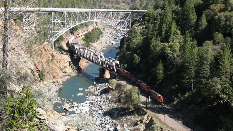 Crossing highway and railroad bridges. – advrider.com