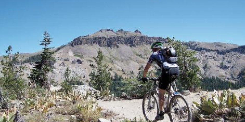 A mountain biker tops out on Andesite Ridge on the Hole in the Ground trail. Trail crews have been busy maintaining the popular Donner Summit trail. – David Bunker/Moonshine Ink