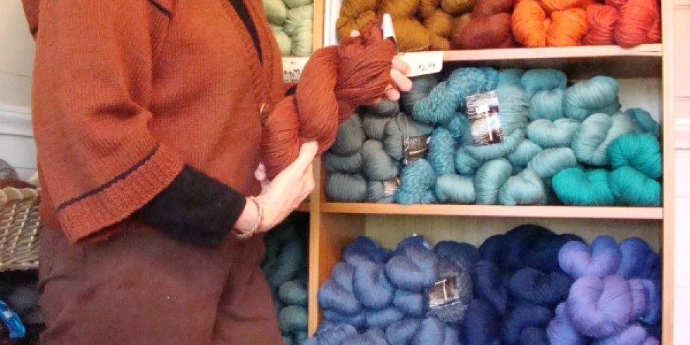 Owner Bonnie Chase shows a few of the yarns available at the Warner Mountain Weavers. – Jean Bilodeaux
