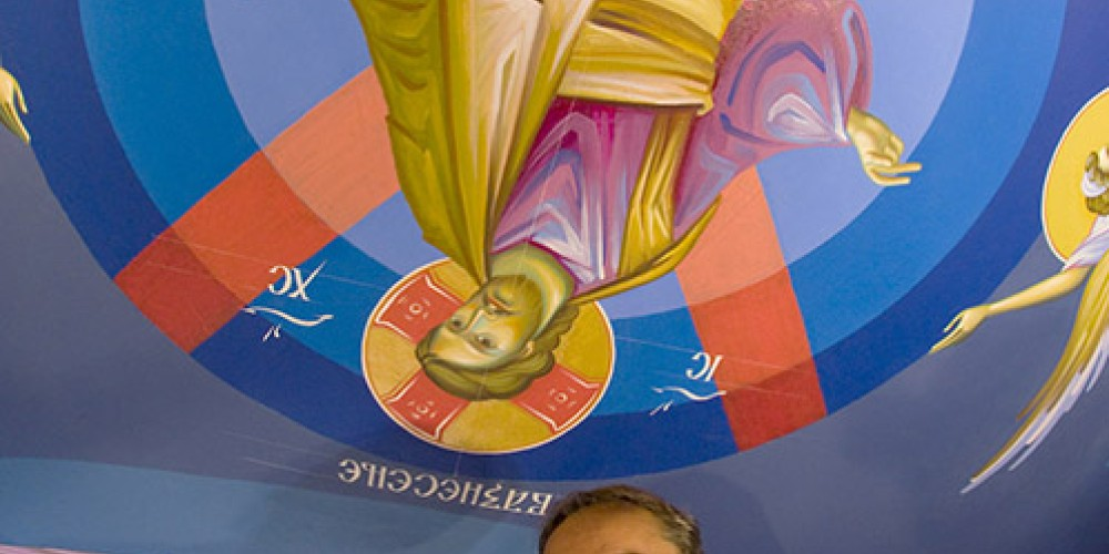 Iconographer Miloje Milinkovic completes the ceiling fresco of Christ rising to heaven, St. Sava Church. – Larry Angier